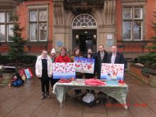 Lamarr group selling hand crafted poppies outside Hyde Town Hall